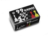 Chequers, ludo and dice games in a silver tin box. The score pad