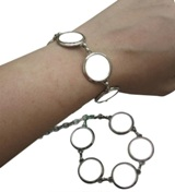 Silver Fashion Bracelet With Clasp And 5 Circles With White Meta