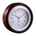 Retro desk clock with a wooden frame includes an alarm function.