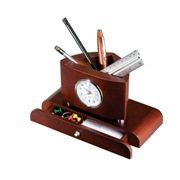 Wooden pen pot and clock with a small drawer.