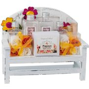 Wellness set, papaya fragrance on wooden bank