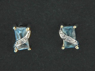 Aqua Cubic Sud With Pave Cross Over Earrings